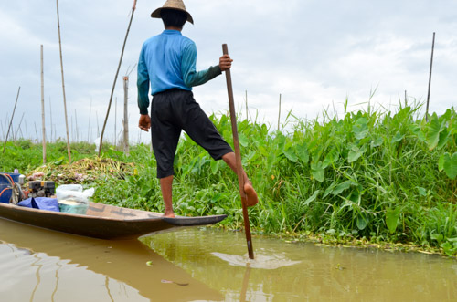 Using feet to paddle at Inle Lake